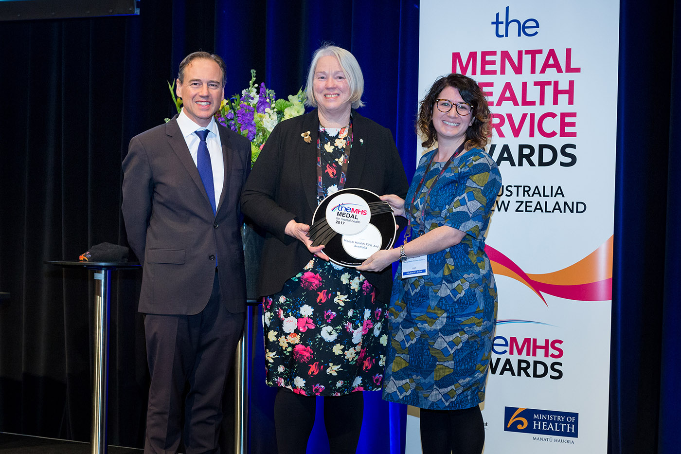 TheMHS Medal 2017 – presented to Mental Health First Aid Australia (Hon Greg Hunt, Betty Kitchener OAM and Nataly Bovopoulos